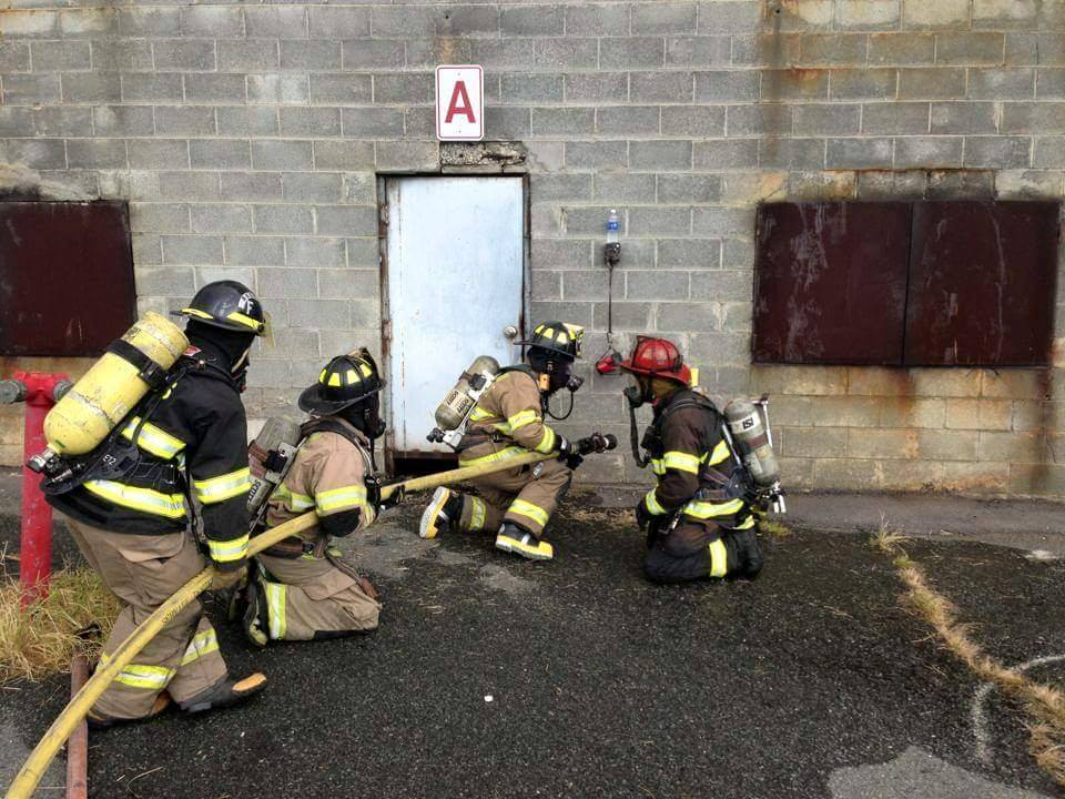 Firefighters Holding a Hose