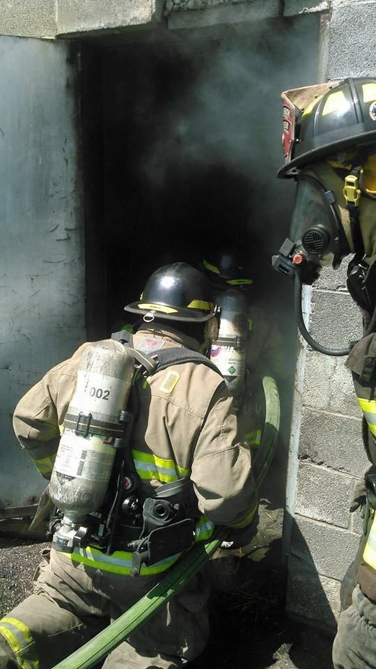 Firefighter Entering a Smokey Building