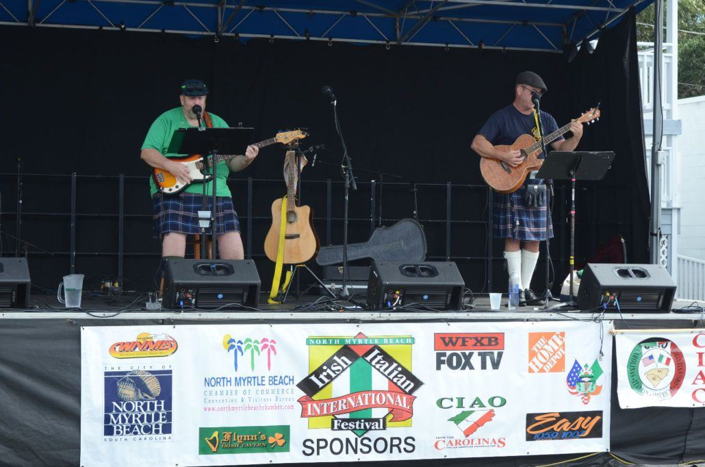 Two Performers in Kilts on a Stage