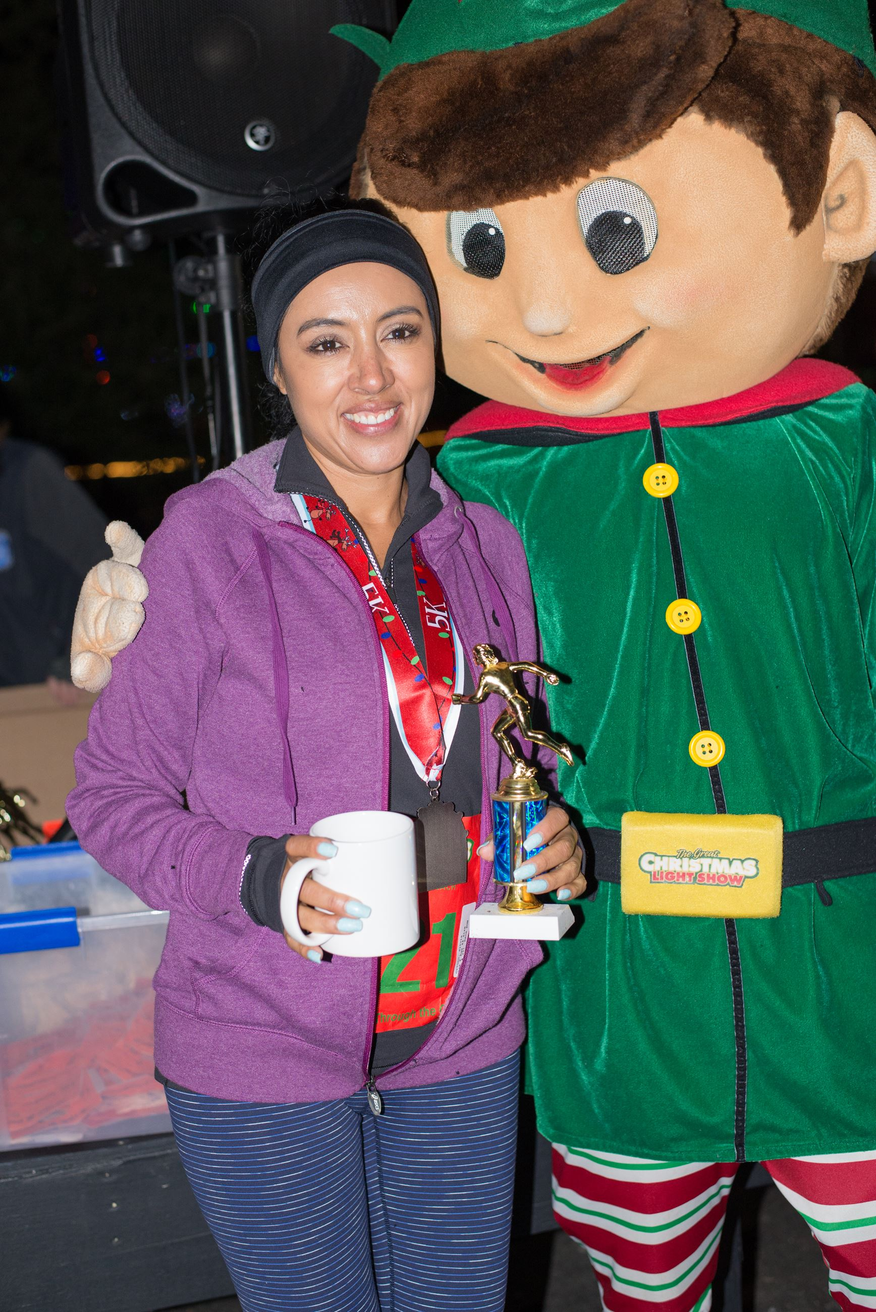 Woman Holding a Mug and Posing with an Elf
