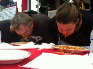 Contestants in a Spaghetti Eating Contest